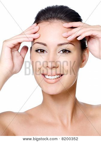 Happy Woman Touching Her Forehead