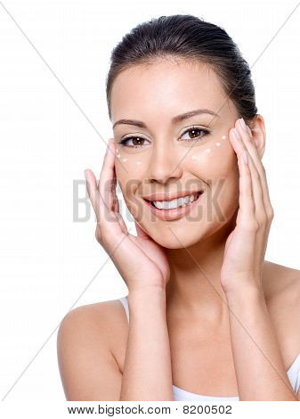 Smiling Woman's Face With Cream On It