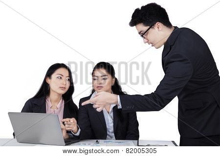 Confident Businessman Explaining A Job