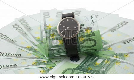 Time Is Money. Watch And 100 Euros Isolated On A White.
