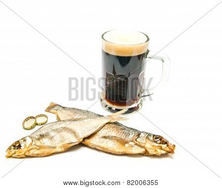 Salted Fish And Glass Of Dark Beer On White
