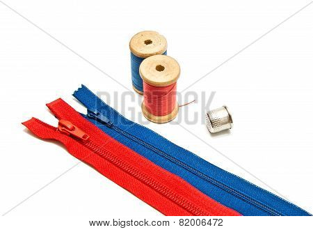 Two Zipper, Thimble And Two Spools Of Thread