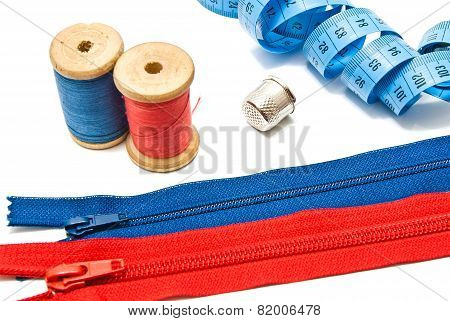 Two Zipper, Thimble, Meter And Spools Of Thread