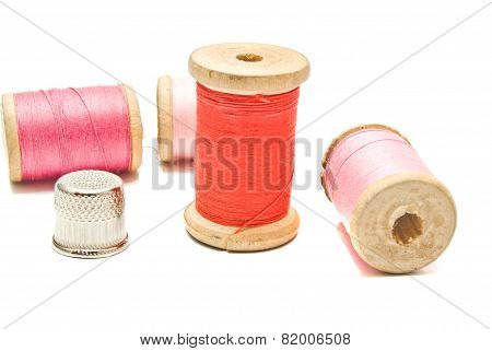 Spools Of Thread And Thimble On White