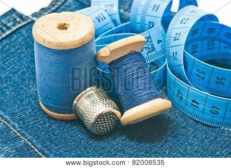 Thimble, Meter And Blue Spools Of Thread