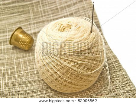 Yarn With Needle And Metal Thimble
