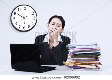Exhausted Businesswoman Yawning At Office 1