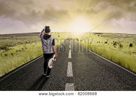 Lonely Guitarist Walking On Road 2