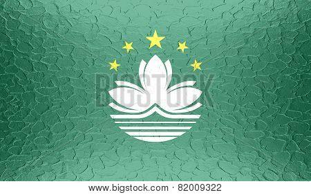 Macau flag on metallic metal texture
