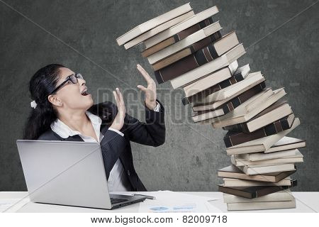 Worried Woman Holds A Falling Book