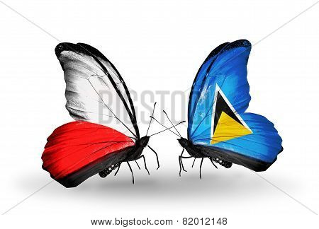 Two Butterflies With Flags On Wings As Symbol Of Relations Poland And Saint Lucia