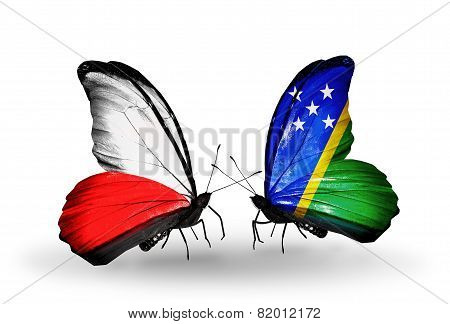 Two Butterflies With Flags On Wings As Symbol Of Relations Poland And Solomon Islands