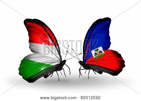 Two Butterflies With Flags On Wings As Symbol Of Relations Hungary And Haiti