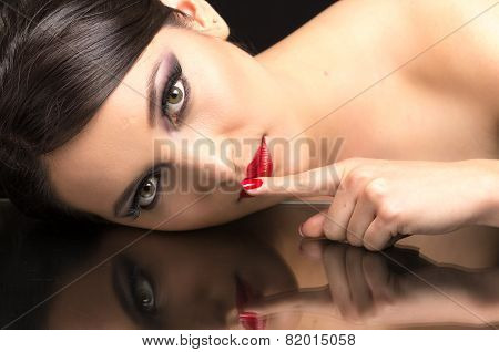beautiful young woman wearing makeup and her reflection
