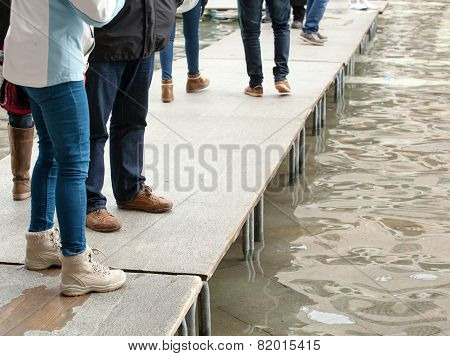 People Walking On Catwalk In Venice