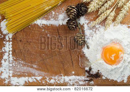 Baking cake. Eggs, flour, wheat on vintage wood table