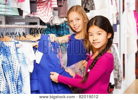 Two beautiful girls shopping together in the store