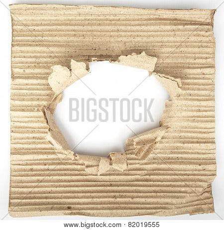 Old Cardboard Paper With A Big Hole In The Middle