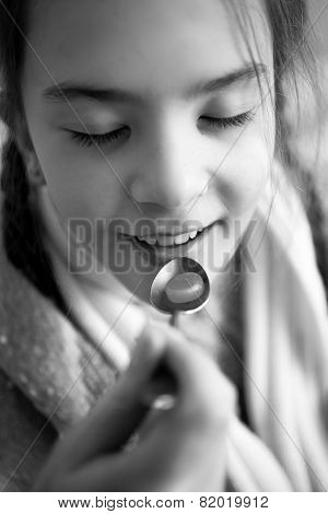 Monochrome Photo Of Little Girl Taking Medicines On Spoon