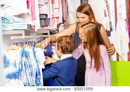 Woman with two children shopping together