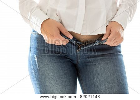 Sexy Slim Woman Putting On Blue Jeans