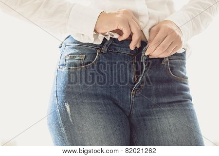 Sexy Woman Unbuttoning Her Jeans