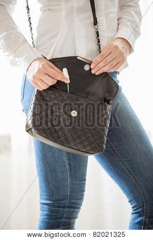 Young Stylish Woman Taking Tampon From Handbag