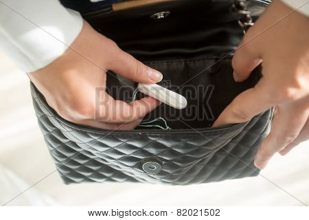 Young Woman Taking Menstrual Tampon From Purse
