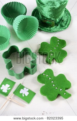 Happy St Patricks Day Cooking And Baking Concept With Green Cupcake Pans And Shamrock Cookie Cutter