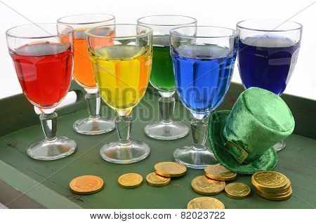 Happy St Patricks Day Party Rainbow Color Drinks With Decorations On Vintage Wood Table.