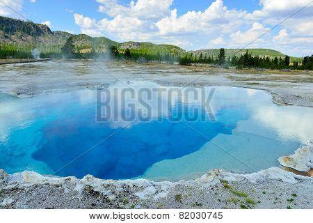Clouds Reflecting In The Sapphire Pool In Biscuit Basin In Yellowstone National Park In Summer