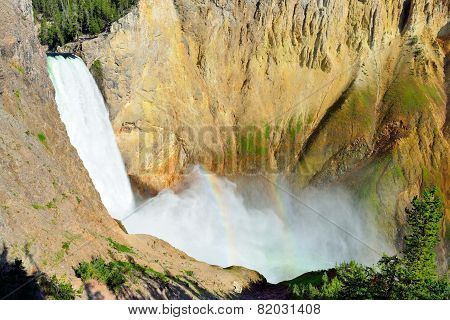 Waterfall With A Rainbow In The South Rim Of The Canyon Of The Yellowstone In Wyoming During Summer