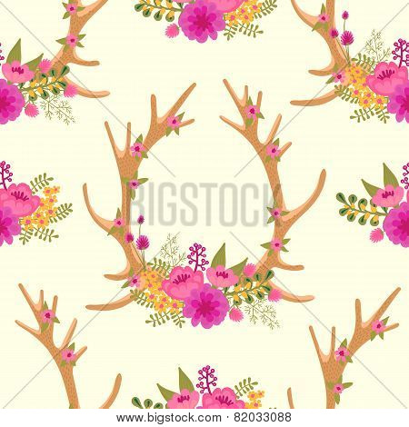 Vintage seamless pattern with deer antlers and flowers.