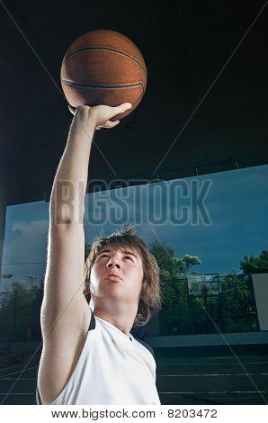 Teenager Shooting Basketball