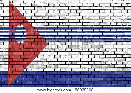 flag of Artigas Department painted on brick wall