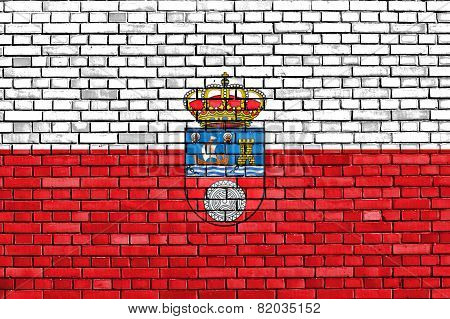 flag of Cantabria painted on brick wall