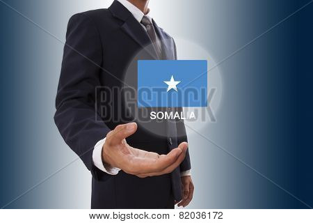 Businessman hand showing Somalia Flag