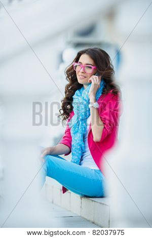 Portrait of a woman talking on a mobile phone.