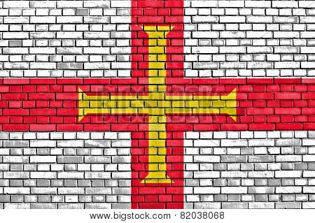 Flag Of Guernsey Painted On Brick Wall
