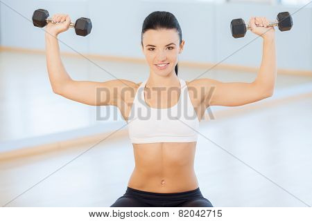 Young Woman Doing Arm Curls.