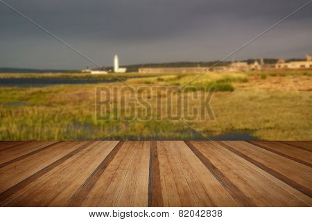 Landscape Of Wetlands Foliage During Stormy Sky Sunset Towards Lighthouse With Wooden Planks Floor