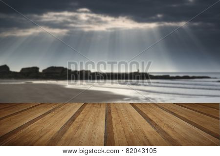 Stunning Sun Rays Bursting From Sky Over Empty Yellow Sand Beach Landscape With Wooden Planks Floor