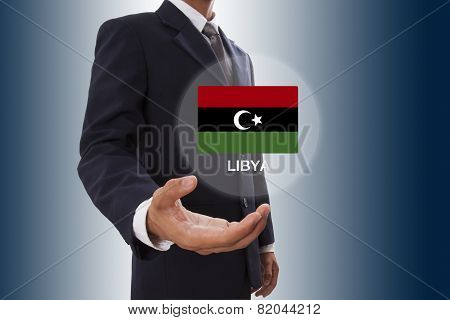 Businessman hand showing Libya Flag