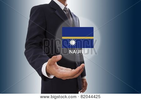 Businessman hand showing Nauru Flag