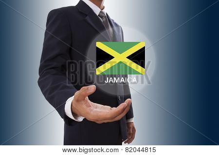 Businessman hand showing Jamaica Flag