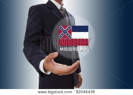 Businessman hand showing Mississippi Flag