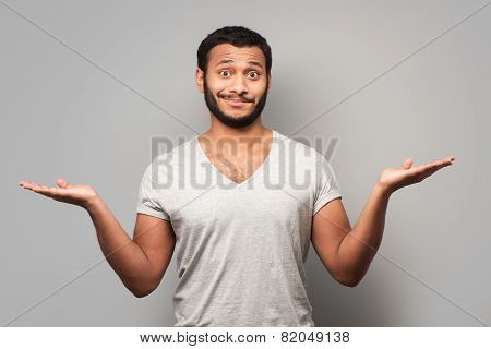 Mixed race man spreading his hands