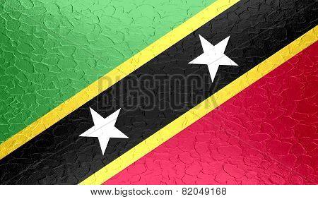 Saint Kitts and Nevis flag on metallic metal texture