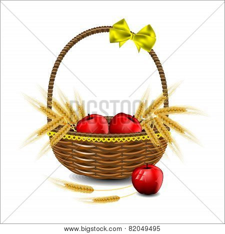 Wheat Ears And Red Apples In A Wicker Basket.