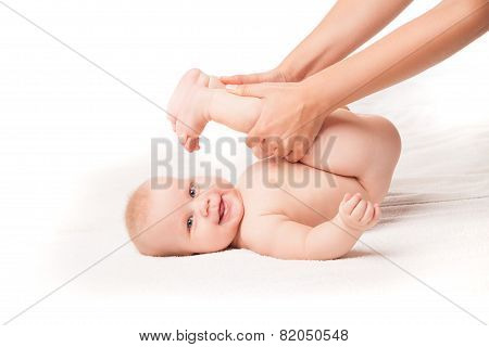 Cute baby lying. legs pulled to face